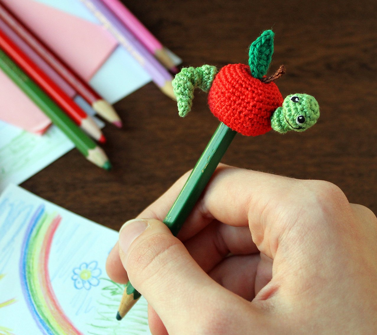 Apple and worm. Pencil decor.