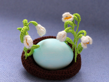 Easter nest with snowdrops