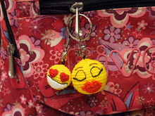 """Emoji in love"" keyrings"