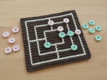 "Crochet pattern for a popular board game ""Nine men's morris"""