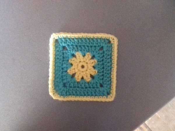 Two granny square patterns with flower