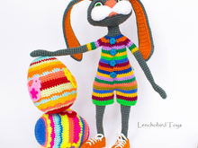 Amigurumi pattern for the Easter bunny. Colorful crochet sporty rabbit