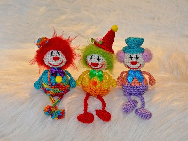 little sitting Clown several variants carneval funny present harlequin